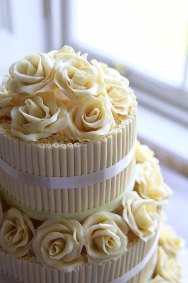 white chocolate yellow pastel wedding cake