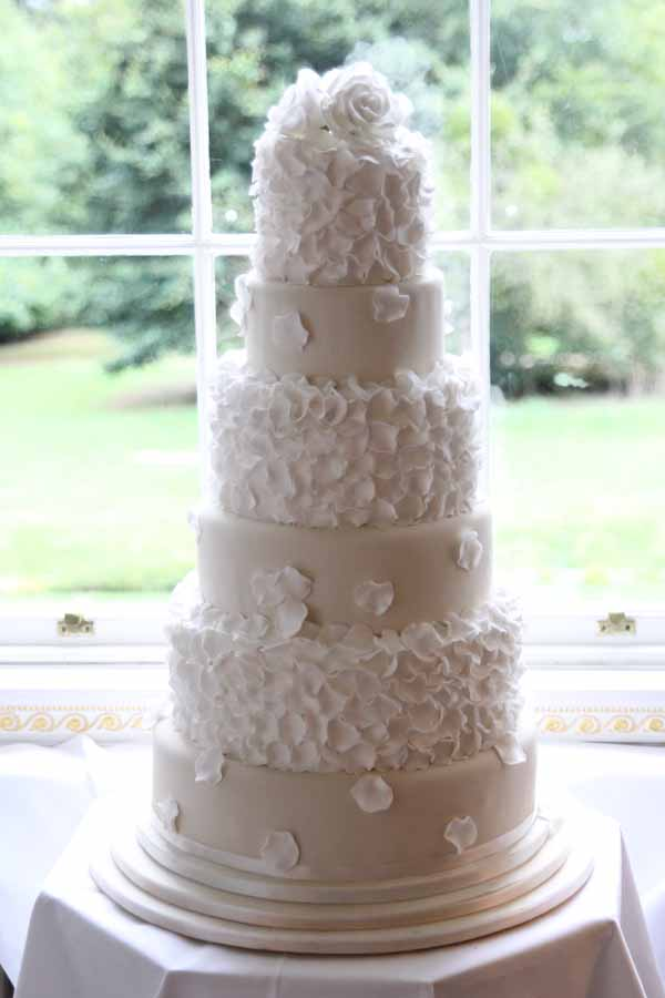 white rose and petals wedding cake idea