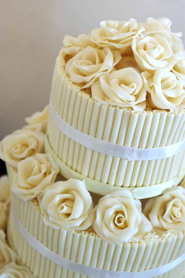 yellow wedding cake with flowers