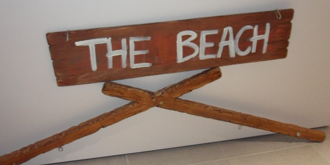 the beach sign call it spring event debenhams