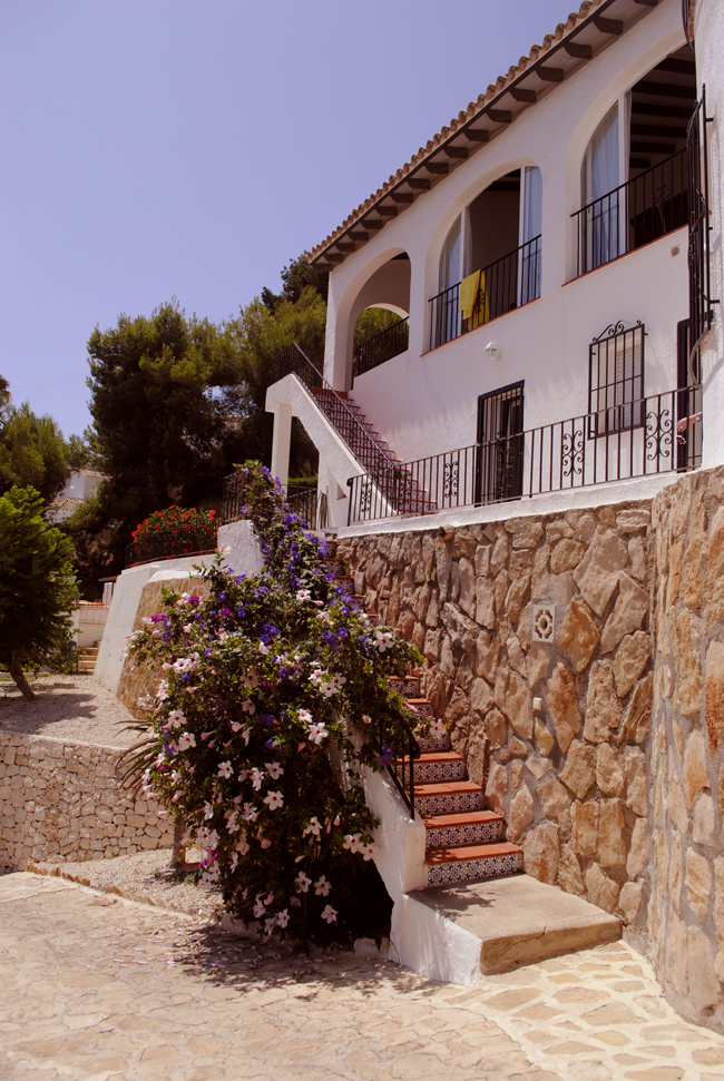 spanish villa exterior design  building hill stone