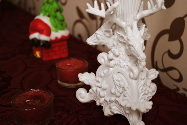 Christmas table detail of candlestick holder