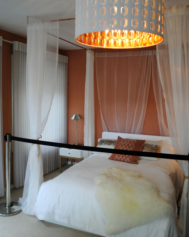 white copper bedroom with warm light tulle and chic bed frame ideal home show