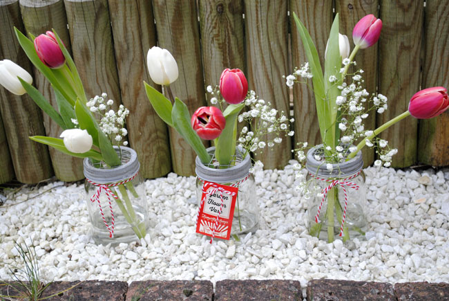 flower arrangement with my garden jars tulips and greenery