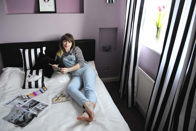 lifestyle and interiors blogger bedroom black and white stripes monochrome and purple accents