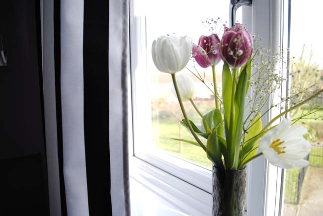 tulip flowers in bedroom striped curtains black and white