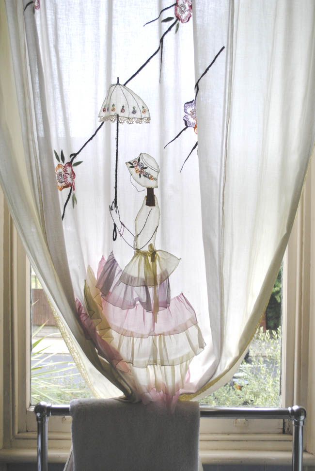 embroidered curtain of a girl holding umbrella victorian
