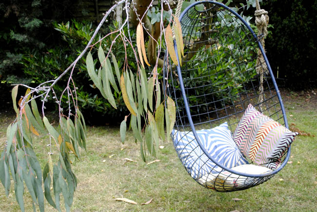 garden swing with cushions tree hanging relaxing outdoors