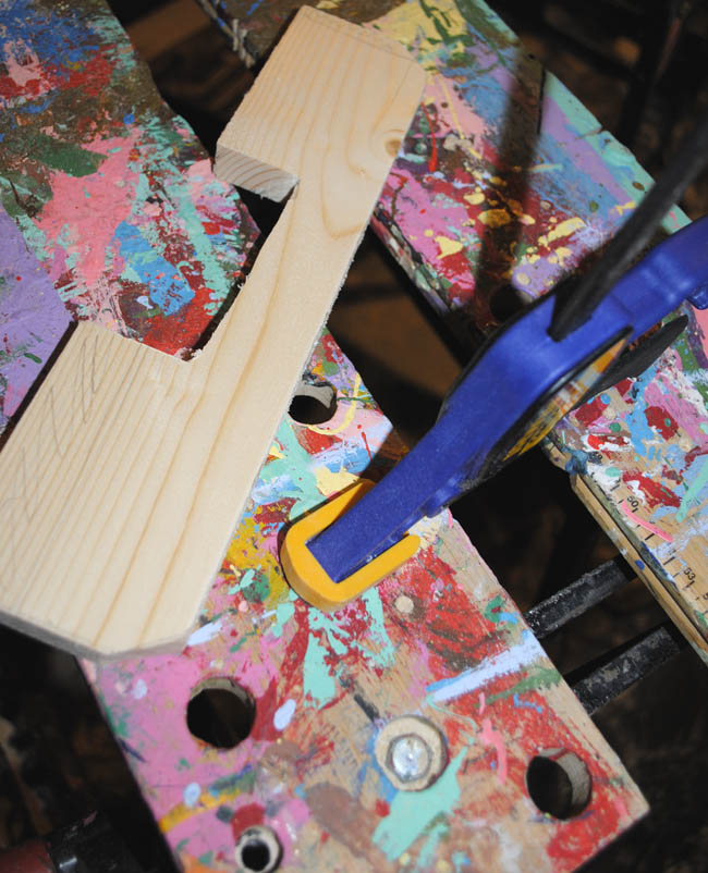cutting wood to the shape of your letter with hand saw