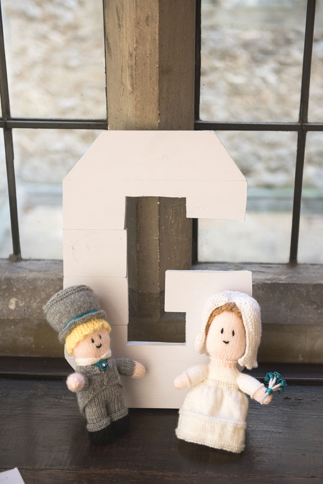 letter G at ghost wedding with bride and groom
