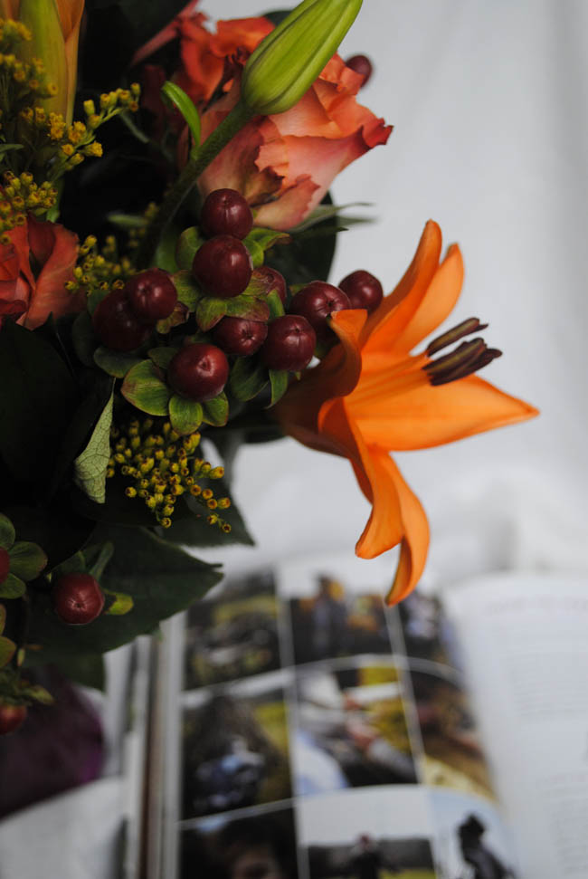 orange lilly woodland flowers bouquet and bonfire book