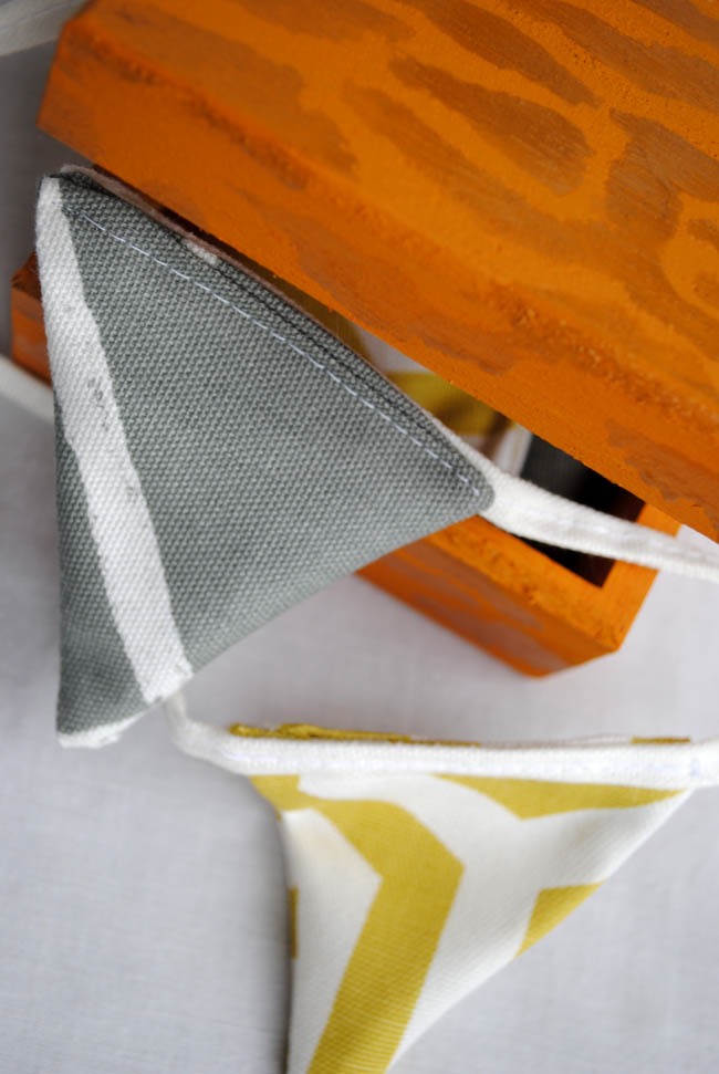 bunting grey and yellow prestigious fabric and orange box