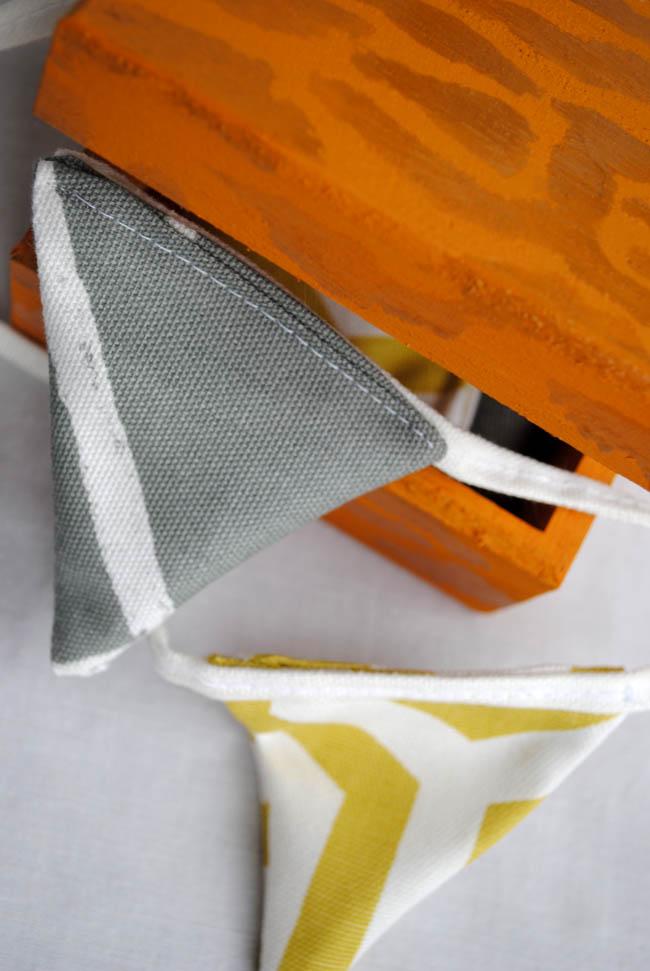 bunting grey and yellow prestigious fabric and orange box