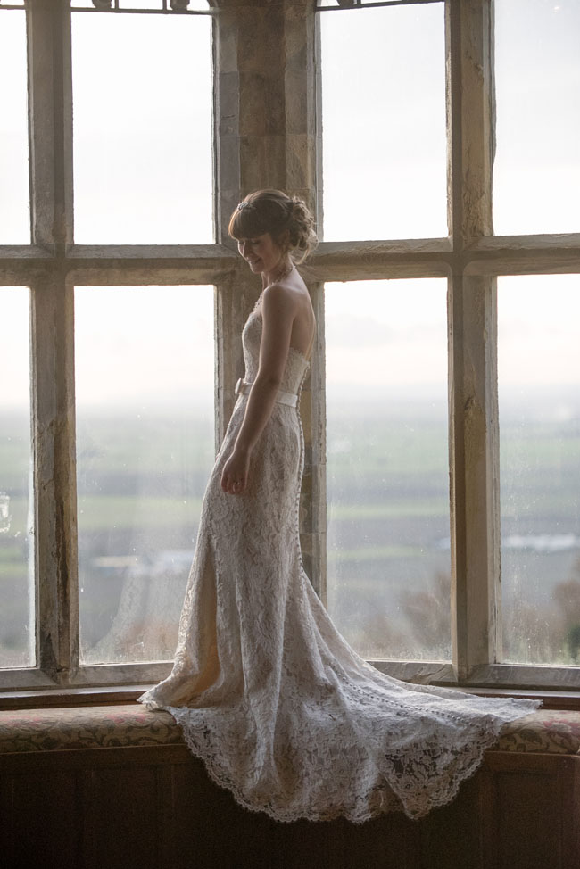 lace wedding dress on window sill lympne castle view