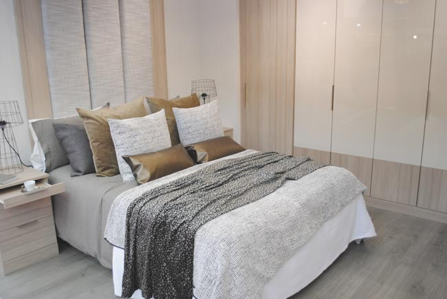 cushions and throws in a rented bedroom