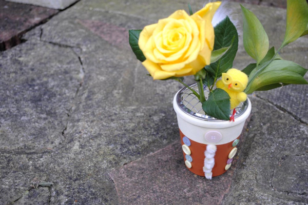 Easter DIY plant pot with chick and yellow rose