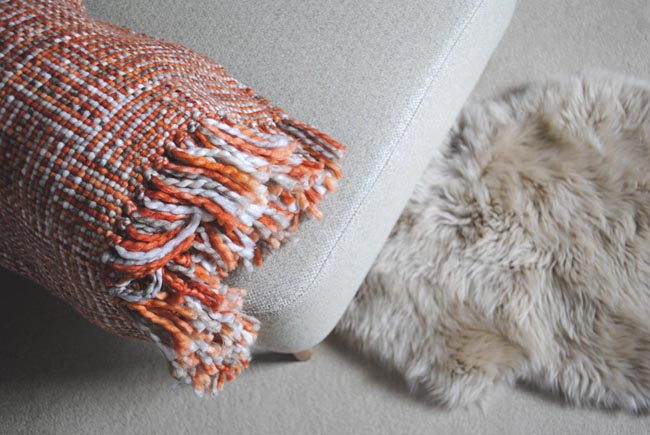 gorgeous snuggly textures of tweed, faux fur rug and fabric sofa