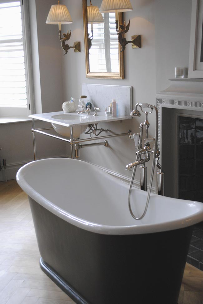 grey black bath tub centrepiece in bathroom