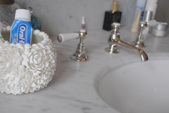 marble sink with brass taps