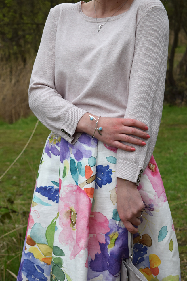 blue bracelet and floral colourful midi skirt