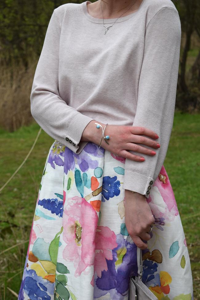 blue bracelet and floral colourful midi skirt