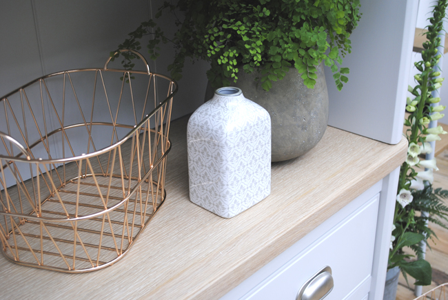 wood effect furniture with home decor accessories metallic