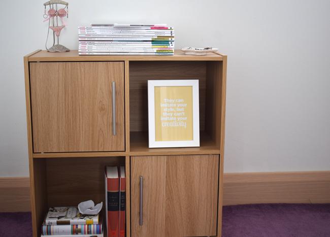 shelf organisation ideas on light wooden storage unit