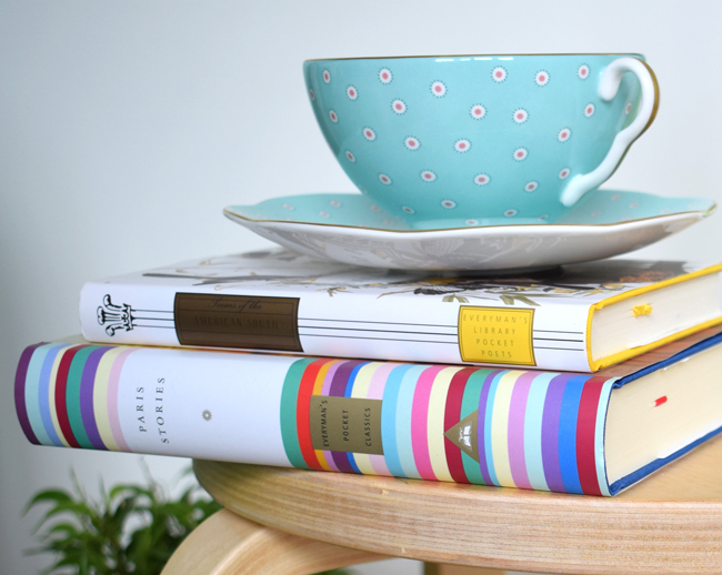 colourful books and cup saucer wedgwood