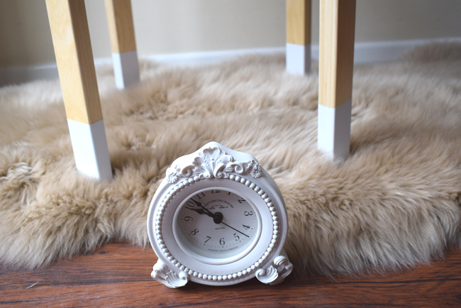 painted legs white with clock and shaggy rug