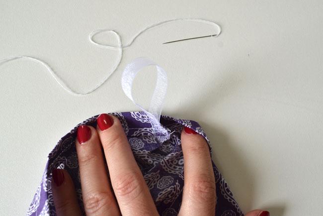 sew a ribbon loop to hang bag holder up