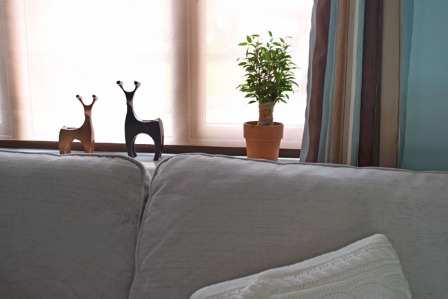 window sill lounge deer candle holders and plant