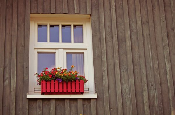 window-of-a-house-with-pretty-flowers