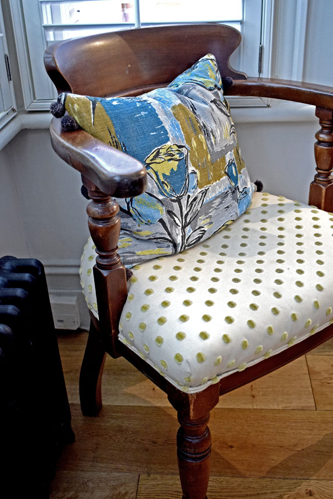 blue-floral-cushion-on-vintage-wooden-chair-interior-styling