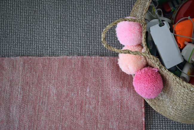 pink-pom-poms-rug-and-textures-wicker-basket
