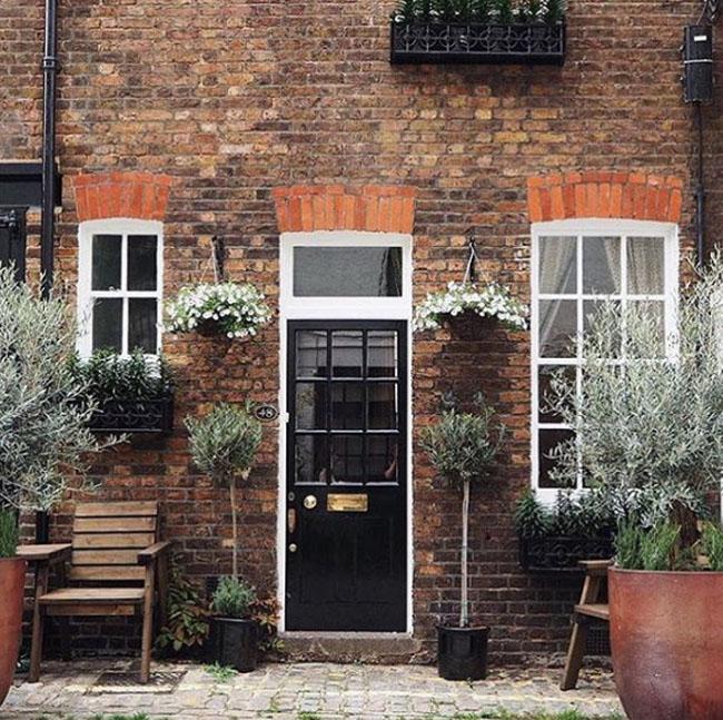 black-front-door-and-brick-walls