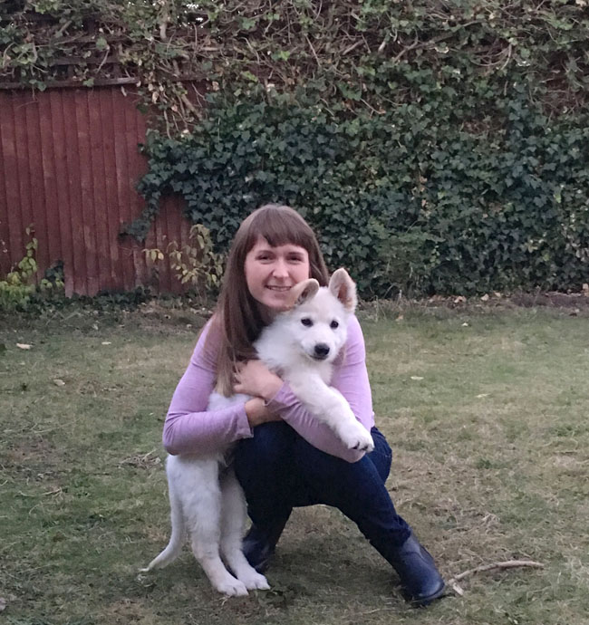 casper-in-alinas-lap-white-geman-shepherd-puppy
